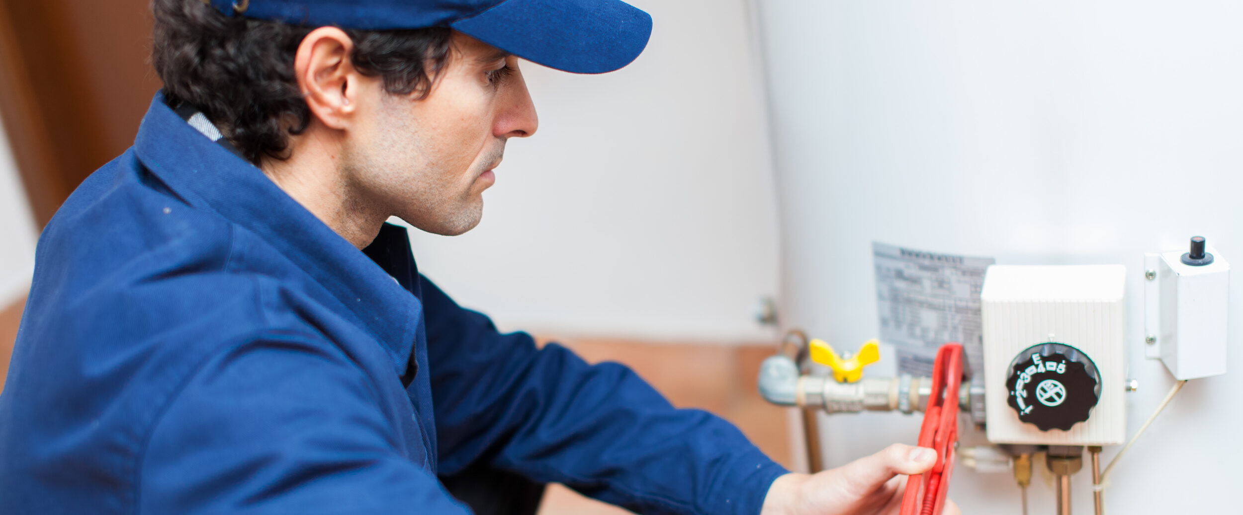 Plumber Working On Hot Water Heater